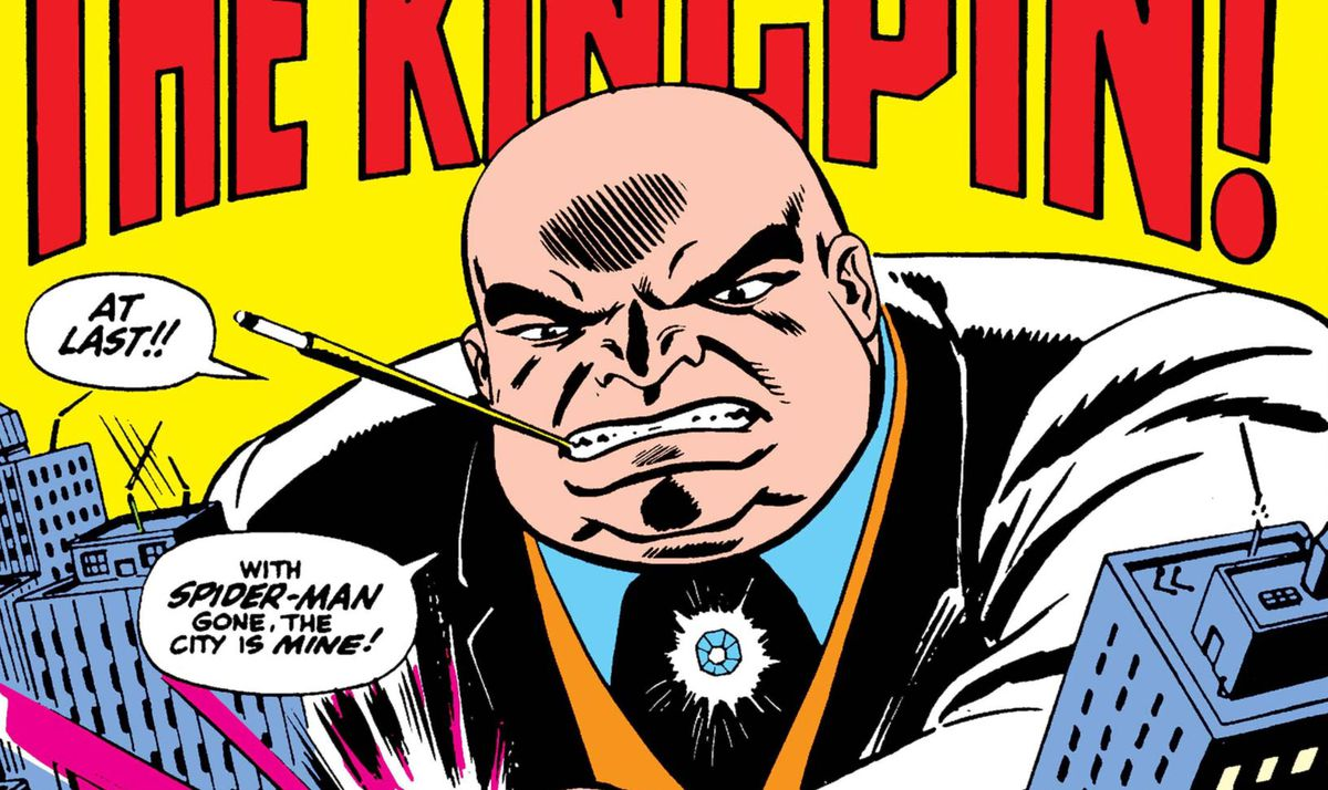 """At last,"" cries the Kingpin, cigarette holder perched between his teeth, ""With Spider-Man gone, the city is mine!"" in The Amazing Spider-Man #51, Marvel Comics (1967)."