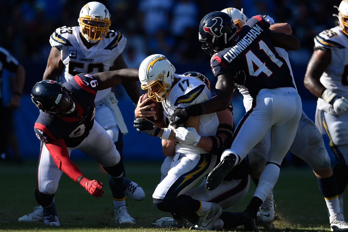 Los Angeles Chargers quarterback Philip Rivers is sacked by Houston Texans defensive end J.J. Watt during the second half at Dignity Health Sports Park.