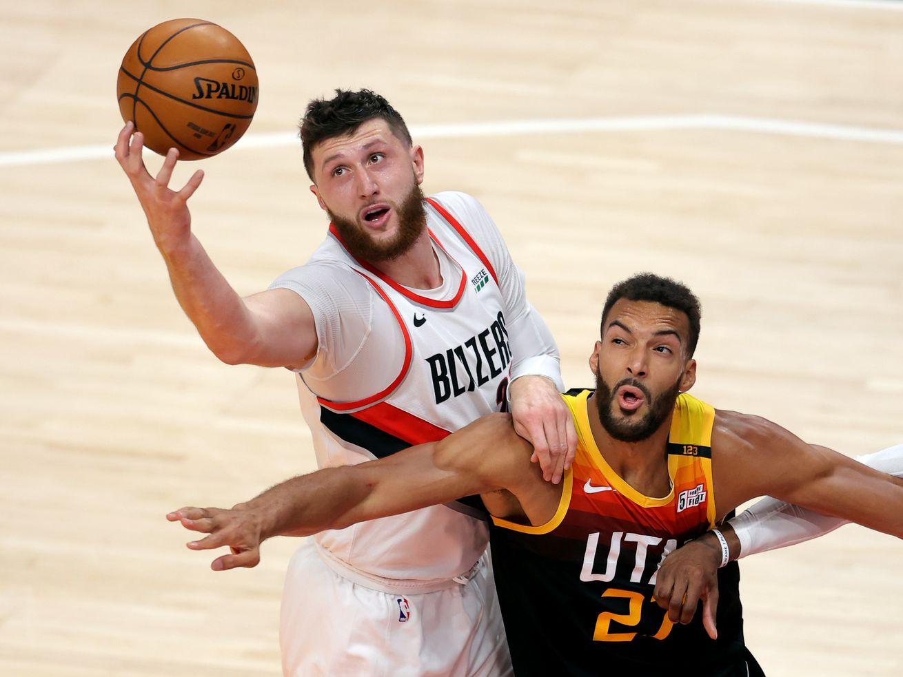 Portland Trail Blazers center Jusuf Nurkic battles for a rebound with Utah Jazz center Rudy Gobert in Salt Lake City.