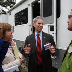 Mayor Ralph Becker, center, talks with Bianca Shreeve, left, Karen Hale, and David Everitt at the temporary emergency operations center for Salt Lake City during The Great Utah ShakeOut, Tuesday, April 17, 2012.
