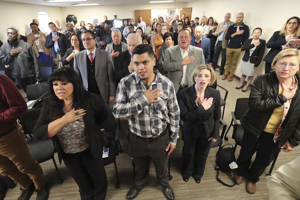 Attendees recite the Pledge of Allegiance during the grand opening of the Salt Lake City-area census office in South Salt Lake on Tuesday, Oct. 1, 2019.