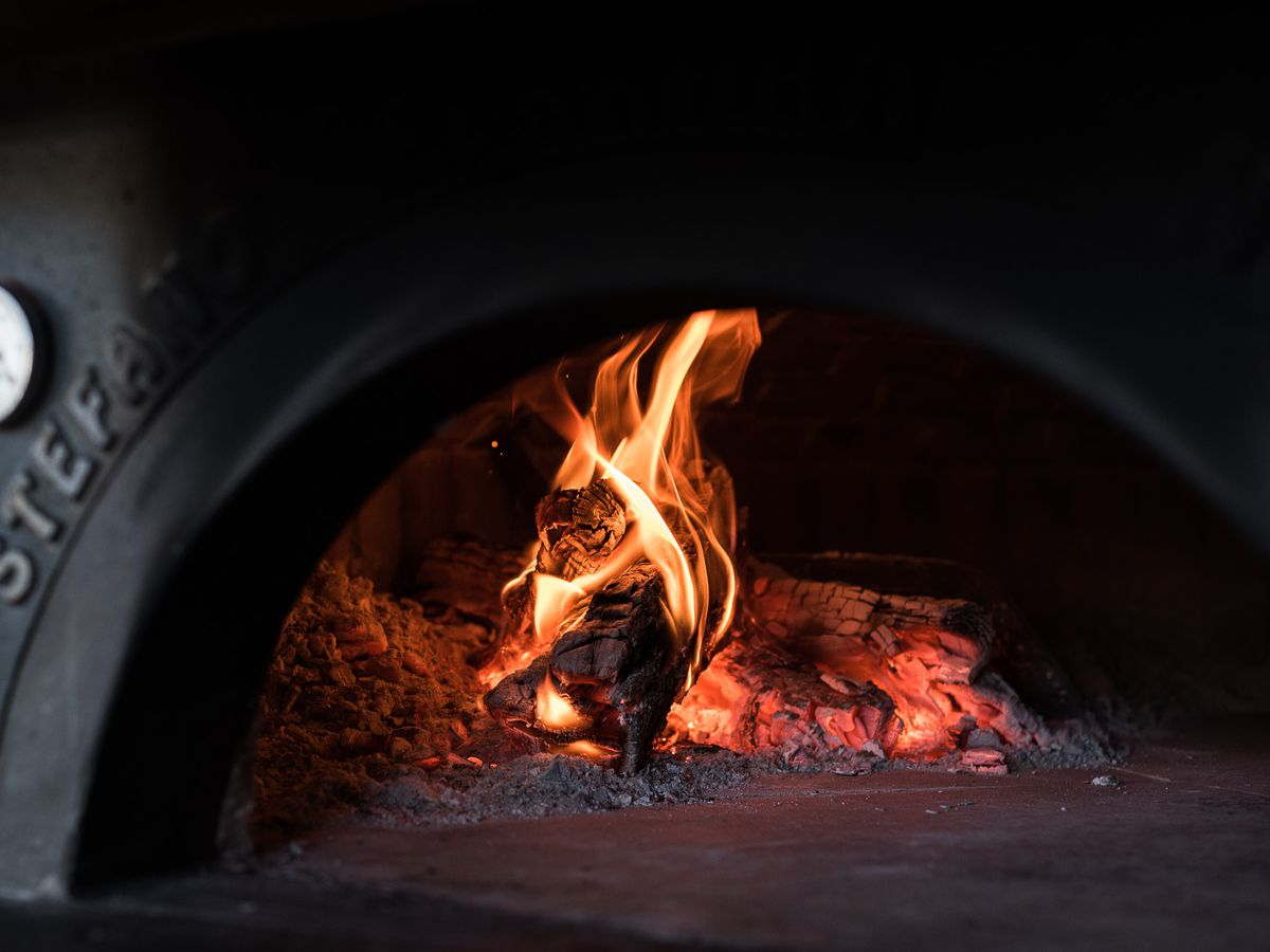 Wood-fired pizza oven at Eataly.