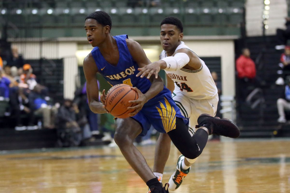 Simeon's Antonio Reeves (3) stays ahead of Morgan Park's Adam Miller (44) in their Public League semi final game at Chicago State University.