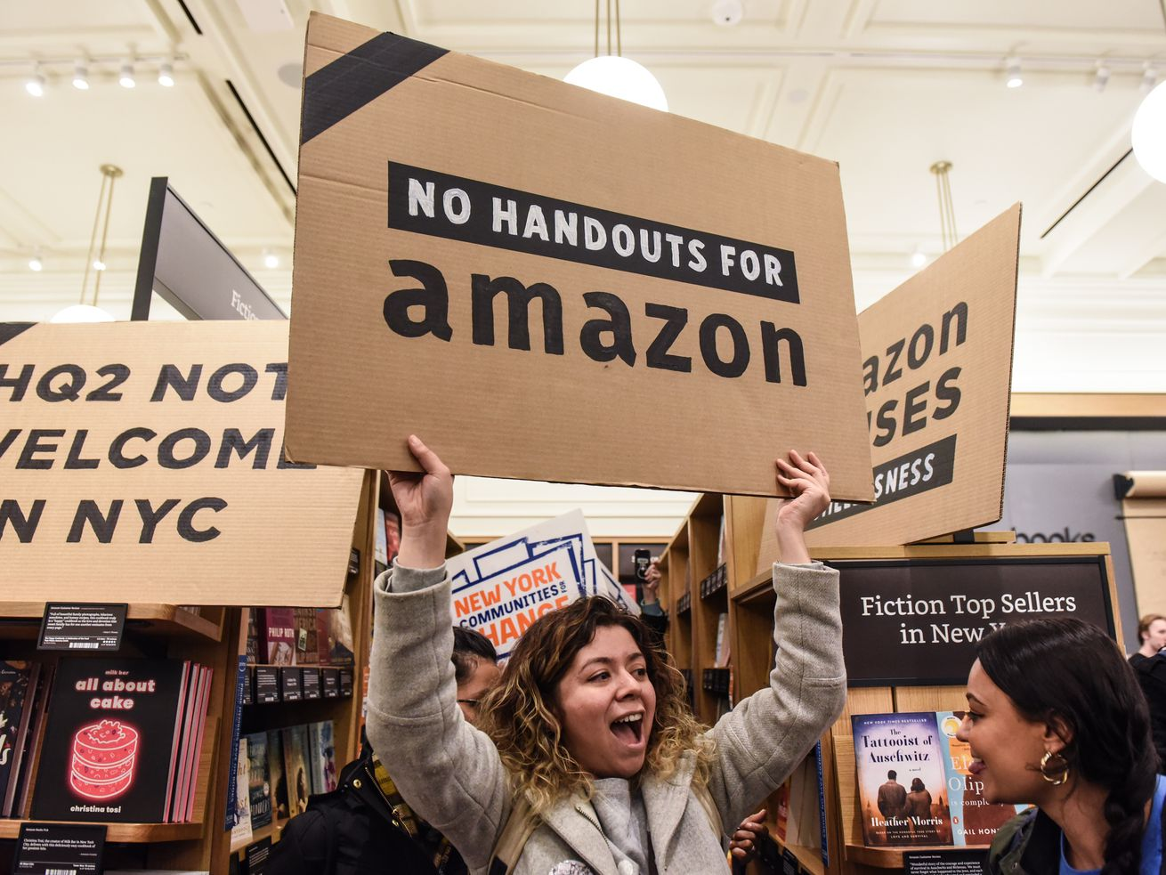 People opposed to Amazon's plan to build a second headquarters in New York hold a protest inside of an Amazon book store in Manhattan on November 26, 2018. Amazon has since scrapped its plan to build a Queens campus.