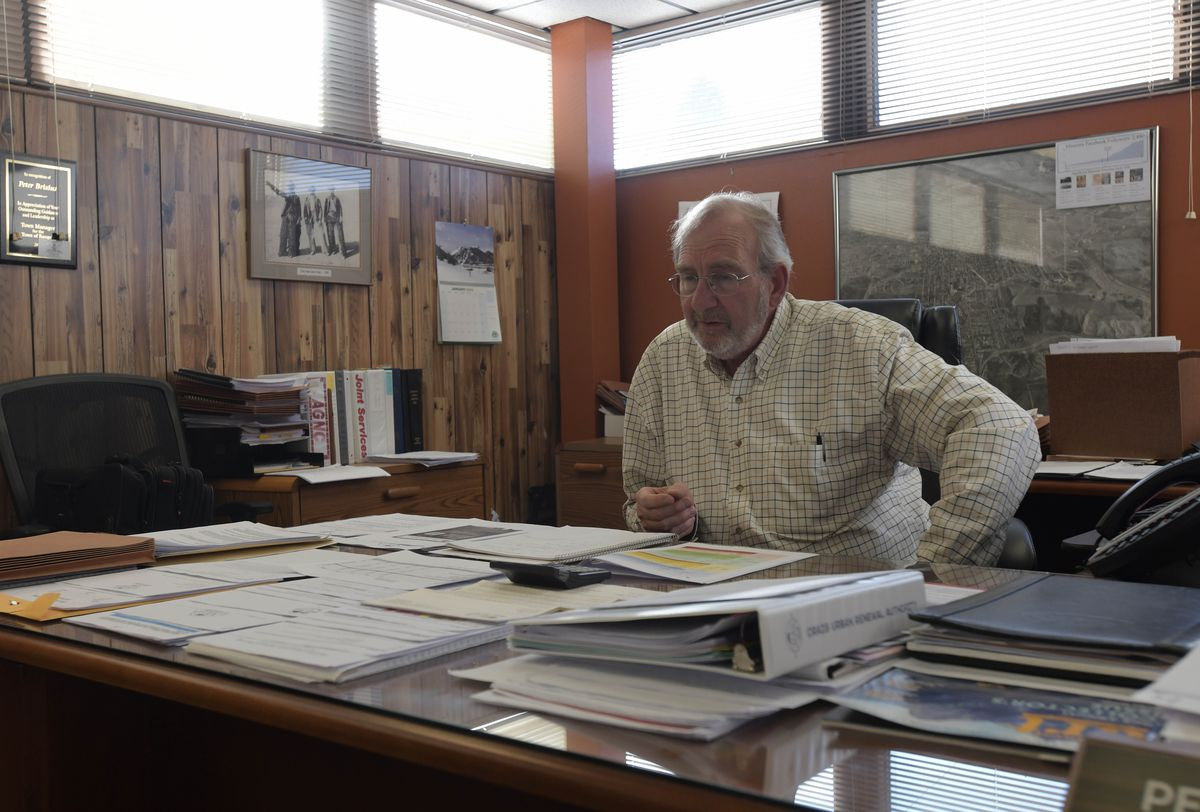 City Manager Peter Brixius sits in his office and discusses the community's economic future as it transitions away from the coal industry.