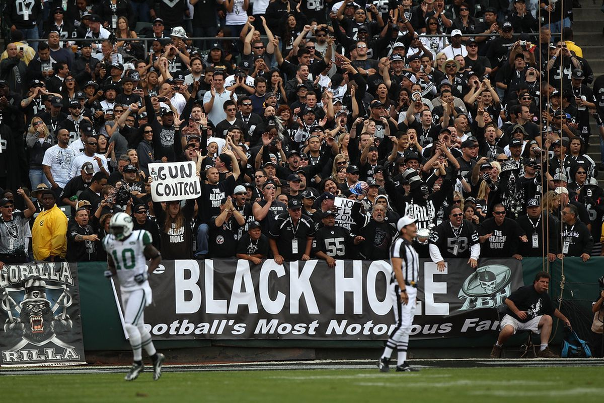 OAKLAND, CA - SEPTEMBER 25:  Fans of the Oakland Raiders cheer against the New York Jets at O.co Coliseum on September 25, 2011 in Oakland, California.  (Photo by Jed Jacobsohn/Getty Images)