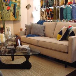 """1) A mid-sized, neutral sofa. Pick something that's big enough to seat you and some friends, yet small enough to fit through your apartment door. <a href=""""http://shophelloworld.com/pages/floor-sample-sale"""">The Philadelphian Sofa</a>, $1,080 on sale at Pin"""