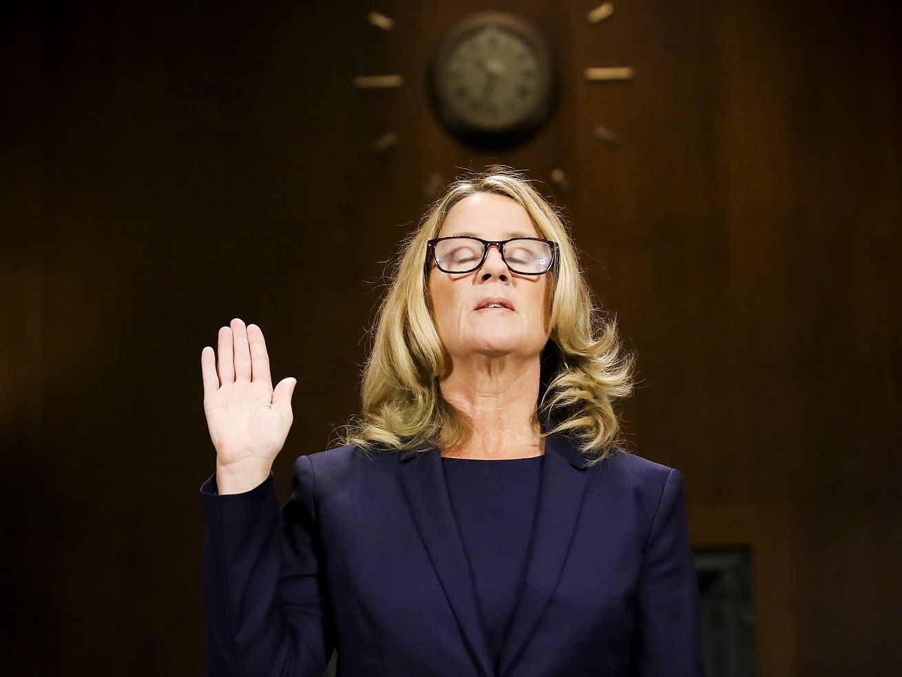 Christine Blasey Ford is sworn in before testifying in front of the Senate Judiciary Committee on September 27, 2018.