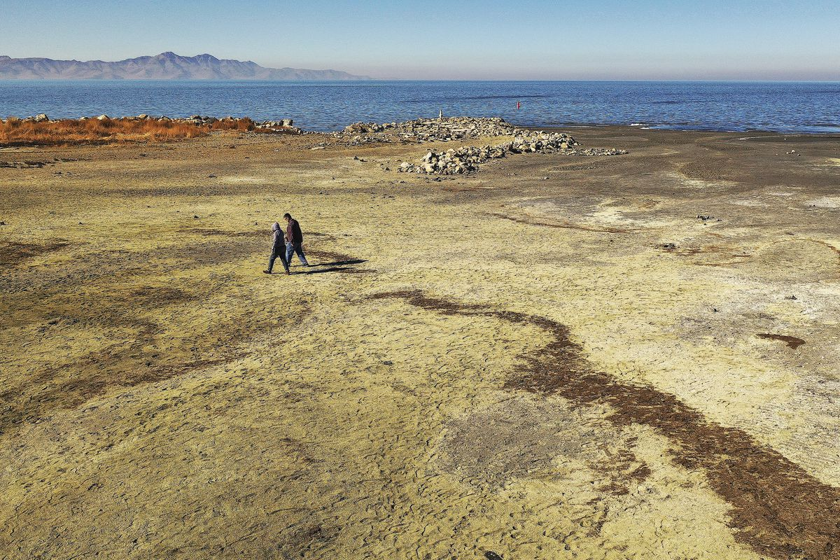 A couple walk near the Great Salt Lake on Wednesday, Oct. 28, 2020. A new study shows water conservation could put off the need for new water development by as long as 2065 and help save the dwindling Great Salt Lake.