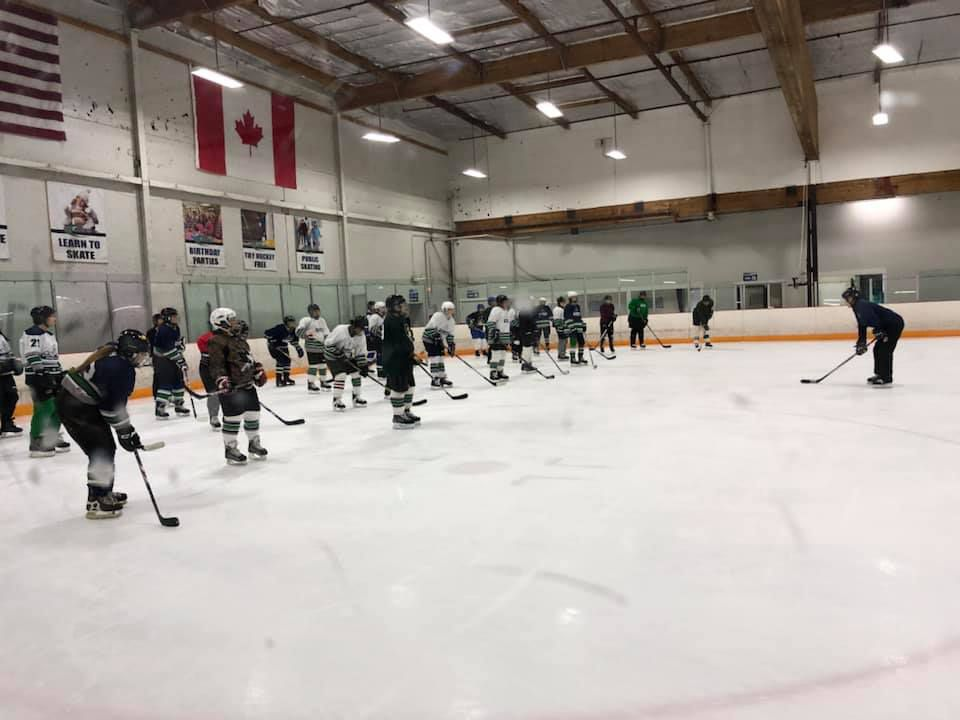 SWHC Try Hockey for Free participants run skating drills