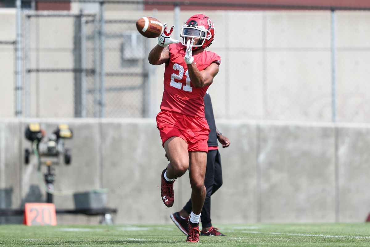 Utah receiver Solomon Enis catches a pass during fall camp at the University of Utah in Salt Lake City.