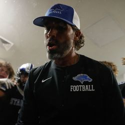 A Stansbury coach celebrates after winning a high school football game against Tooeleat Stansbury High School in Stansbury Park on Friday, Sept. 17, 2021.