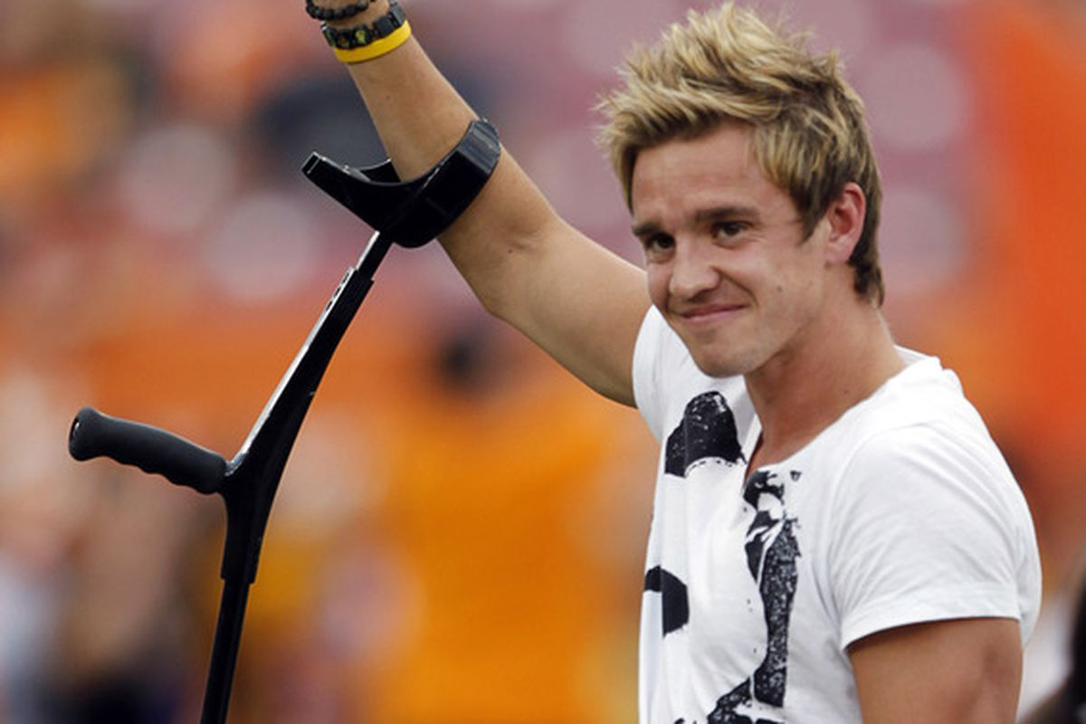 HOUSTON - OCTOBER 23:  Former Houston Dynamo Stuart Holden waives to the crowd before the Houston Dynamo played the Los Angeles Galaxy at Robertson Stadium on October 23, 2011 in Houston, Texas.  (Photo by Bob Levey/Getty Images)