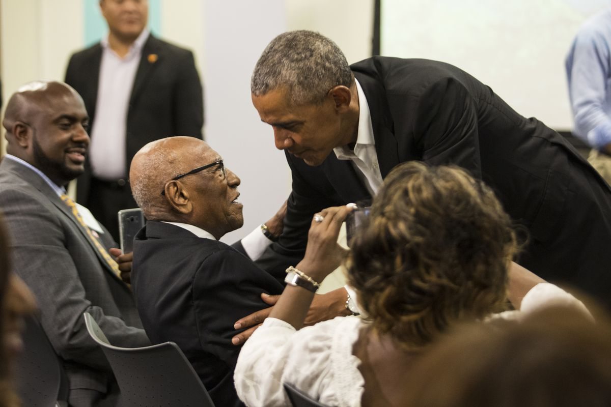 Former President Barack Obama greeting Timuel Black during a meeting in 2018 at the Obama Foundation's headquarters in Hyde Park.