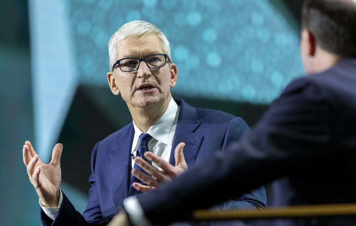Apple CEO Tim Cook, left, talks with Sen. Mike Lee, R-Utah, during the Silicon Slopes Summit at the Salt Palace in Salt Lake City on Wednesday, Oct. 13, 2021.