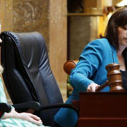 House Speaker Becky Lockhart, R-Provo, uses a gavel to start the session in the House of Representatives at the Utah Capitol in Salt Lake City on Monday, Jan. 27, 2014. At left is Megan Pyrah. Lockhart, the first woman to serve as Utah House speaker, died at her home Saturday, Jan. 17, 2015, from an unrecoverable and extremely rare neurodegenerative brain disease. Lockhart she was 46.