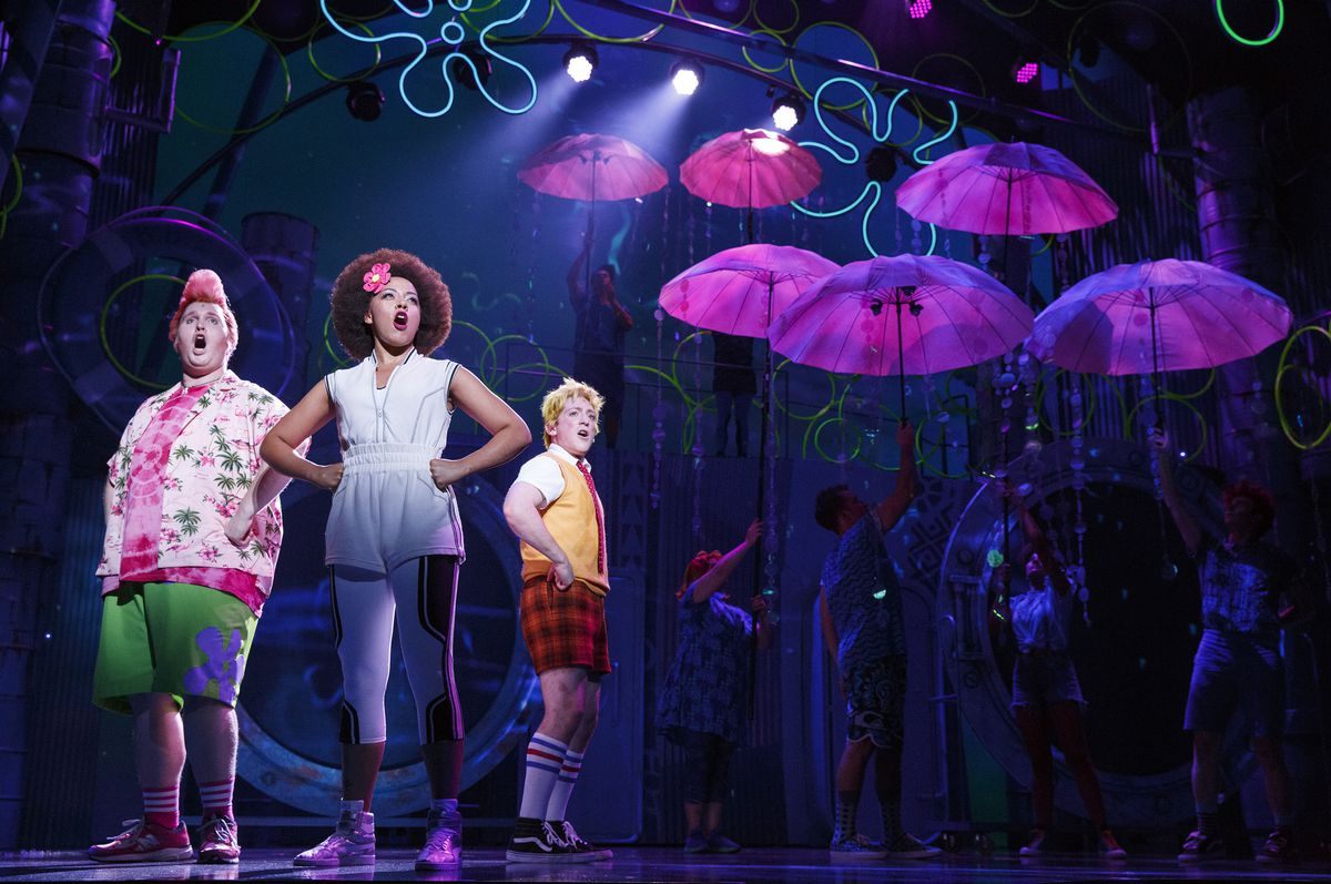 """Danny Skinner (from left) plays Patrick, with Lilli Cooper as Sandy Cheeks and Ethan Slater as SpongeBob in the world premiere of """"The SpongeBob Musical."""" (Photo: Joan Marcus)"""