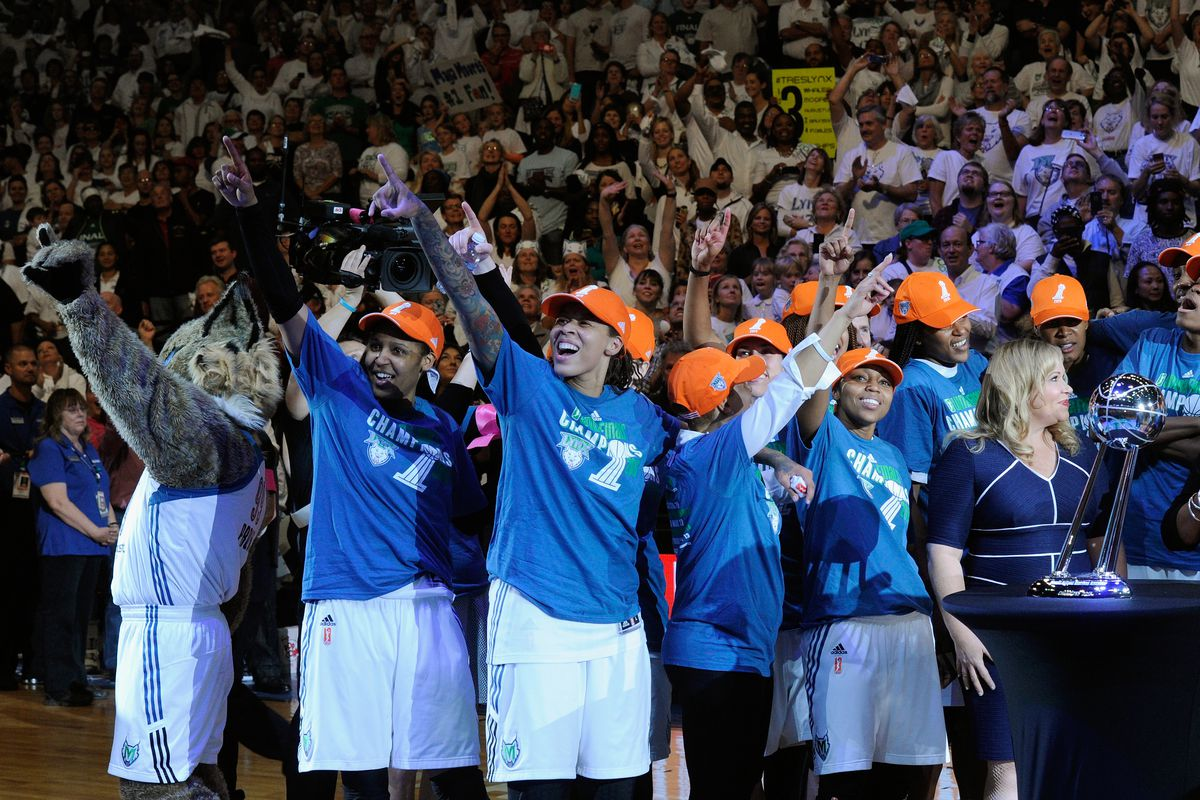 The Minnesota Lynx celebrate a win in Game Five of the 2015 WNBA Finals against the Indiana Fever on October 14, 2015, at Target Center in Minneapolis, Minnesota.