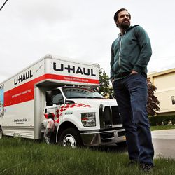 Eric Jackson poses for a portrait in Salt Lake City on Thursday, April 28, 2016, with the truck he is using as a storage place for his family's belongings.