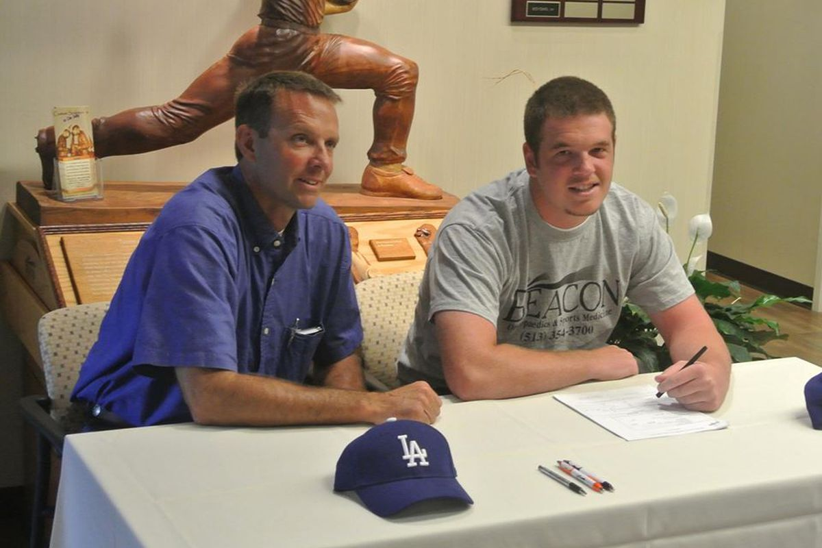 Caleb Ferguson, signing his contract with the Dodgers at the place he had his Tommy John surgery.