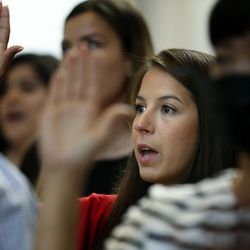 Juliana Roybal, from Brazil, takes the oath of allegiance to become a U.S. citizen at the Capitol in Salt Lake City on Thursday, Aug. 12, 2021. One hundred twenty-four citizenship candidates from 38 countries became U.S. citizens.