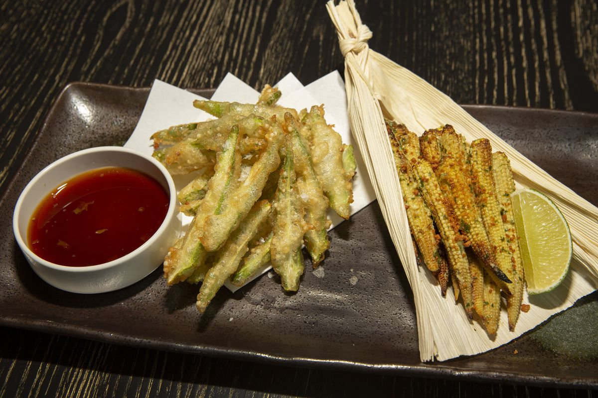 Fried veggies on a platter with ponzu dipping sauce.