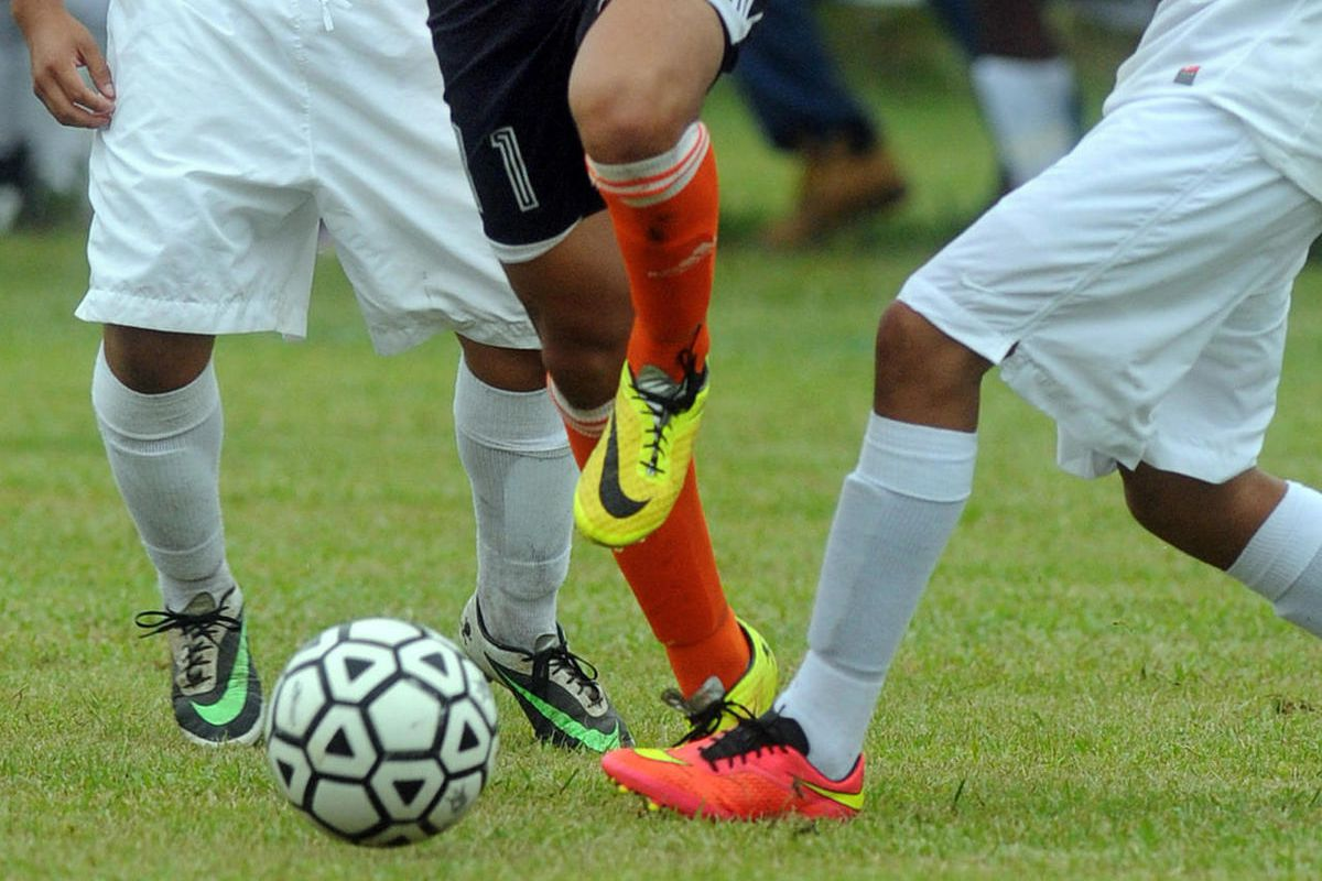 FILE - In this Wednesday, Sept. 24, 2014 file photo, students compete in a high school soccer game in Burgaw, N.C. A study released on Monday, Sept. 11, 2016 found soccer injuries are sending increasing numbers of U.S. youth to emergency rooms, a trend dr