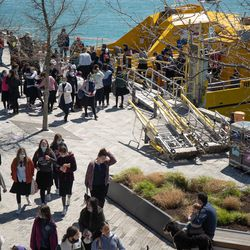 Students step out of a boat at Navy Pier on its reopening day, Friday morning, April 30, 2021. Navy Pier was closed in 2020 due to the COVID-19 pandemic.