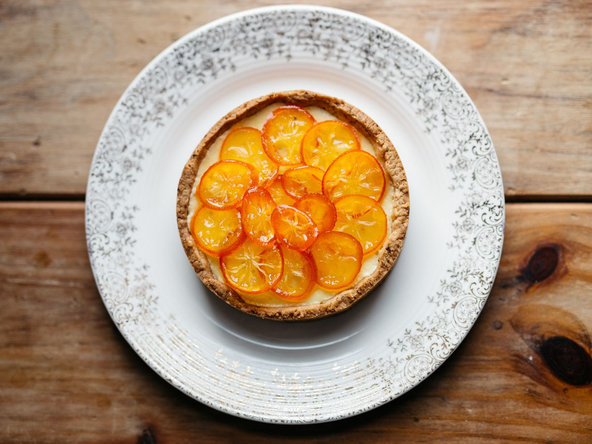 A tart topped with thinly sliced, candied oranges.