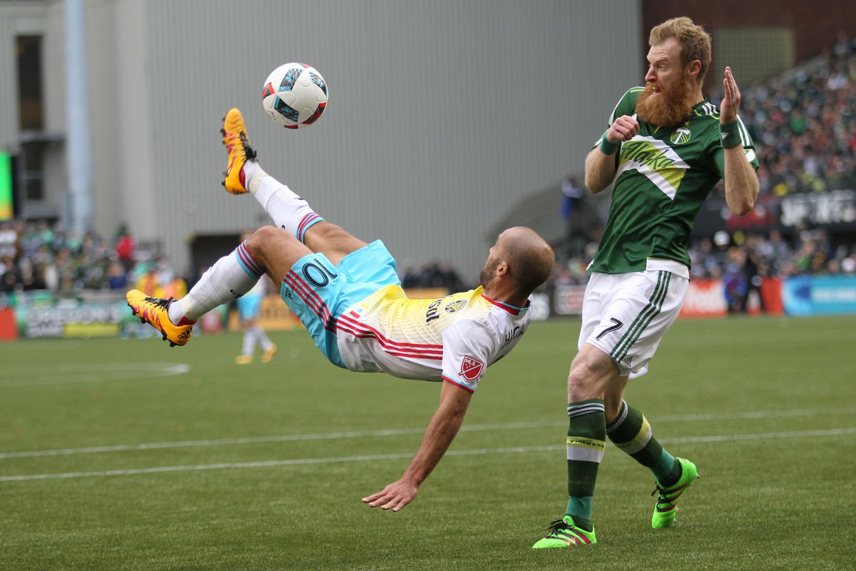 Columbus' Federico Higuain scores on a bicycle kick in a 2-1 loss at Portland in Sunday's season opener.