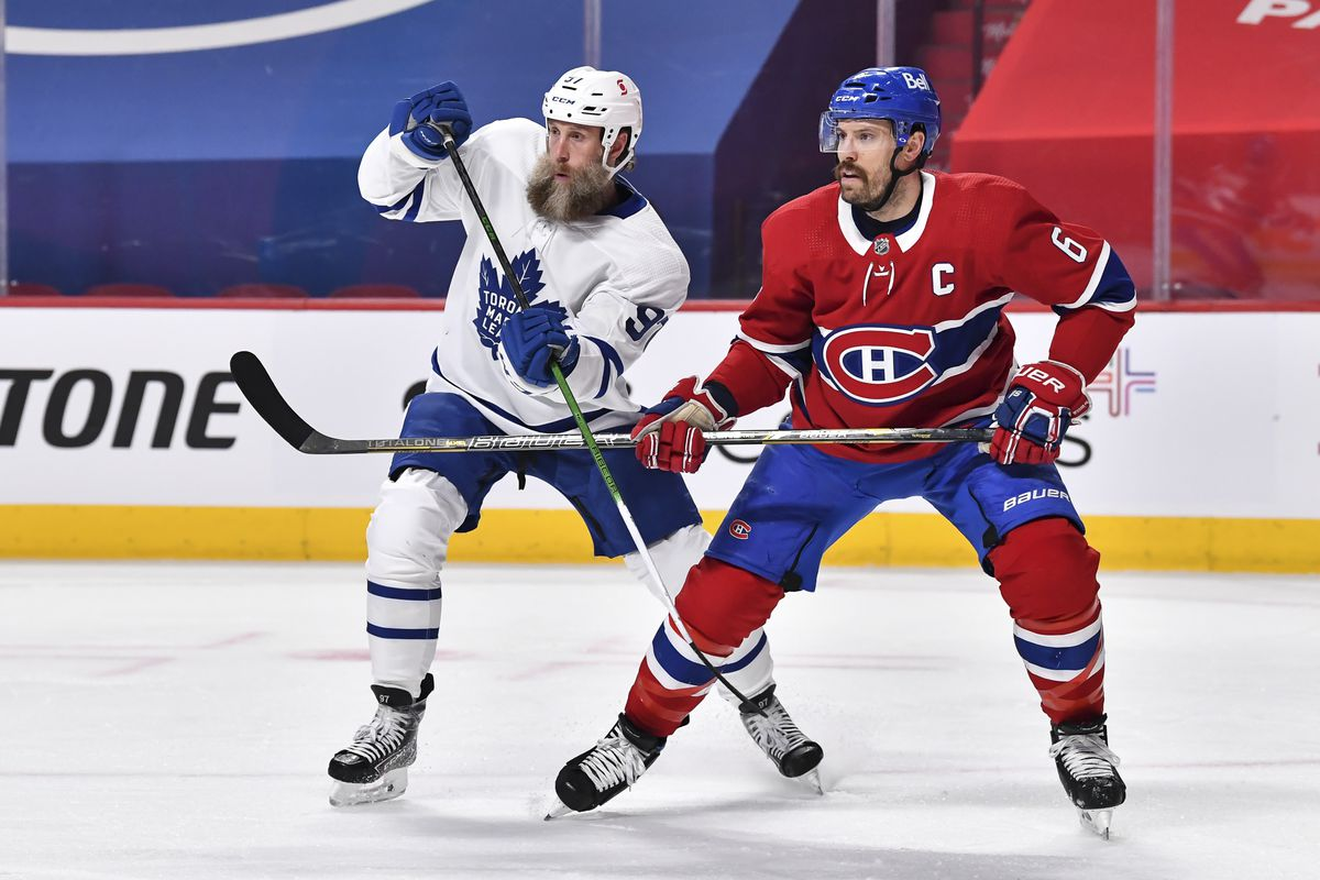 Joe Thornton #97 of the Toronto Maple Leafs and Shea Weber #6 of the Montreal Canadiens skate against each other during the first period in Game Three of the First Round of the 2021 Stanley Cup Playoffs at the Bell Centre on May 24, 2021 in Montreal, Canada.