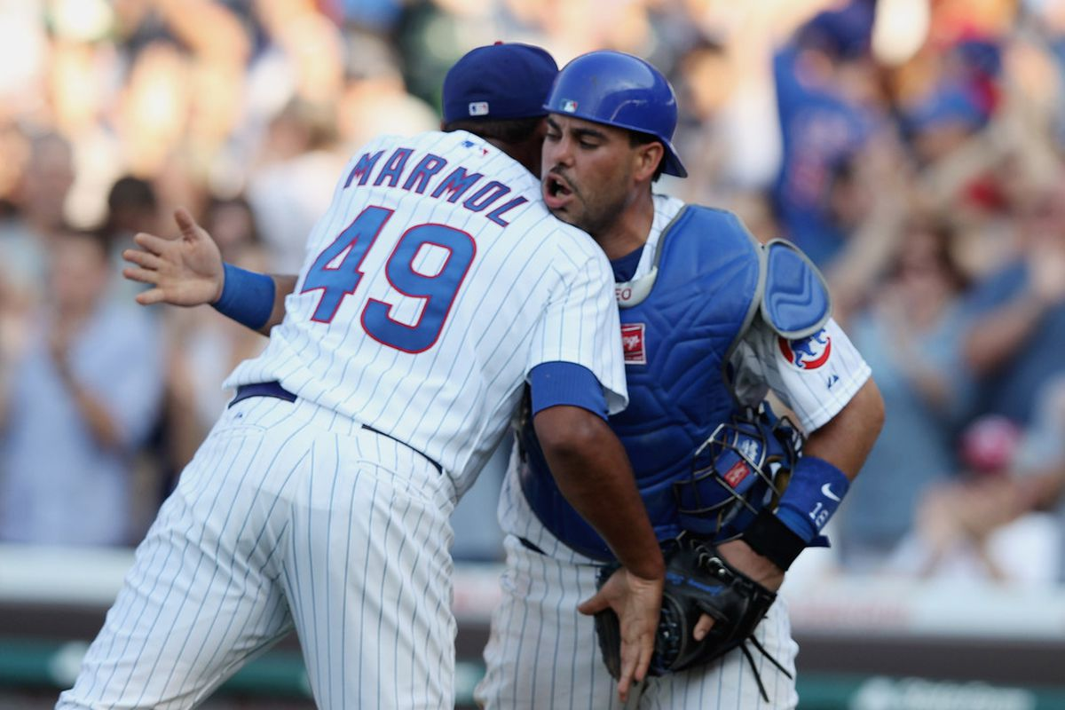 Carlos Marmol of the Chicago Cubs celebrates with catcher Geovany Soto after picking up a save for a 3-2 defeat of the Houston Astros at Wrigley Field in Chicago, Illinois.  (Photo by Scott Halleran/Getty Images)