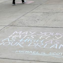 A quote written in chalk is dedicated to graduates on the University of Utah's campus on Thursday, April 30, 2020.