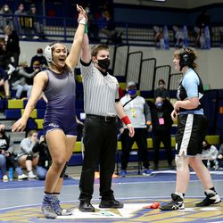 Uno Latu of Hunter celebrates her win over Katie Navarro of West Jordan in class 160 as girls compete for the 6A State Wrestling championship at West Lake High in Saratoga Springs on Monday, Feb. 15, 2021.