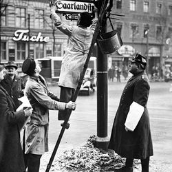 Workmen rename Stresemannstrasse, one of the main streets in Berlin, Germany,  to Saarlandstrasse on Jan. 15, 1935, following the result of the Plebiscite in Saar. The result of the Saar vote was 90.8 percent in favor of returning to a German government.