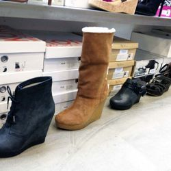 Those wedge booties in front, also Kors, are $69.50
