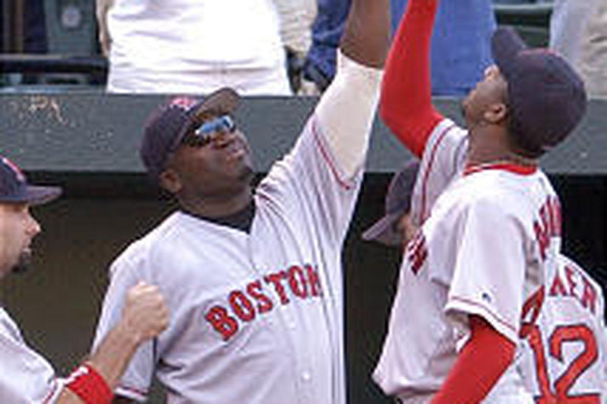 Boston's David Ortiz, left, and Pedro Martinez celebrate after convincing 5-0 victory over Baltimore.