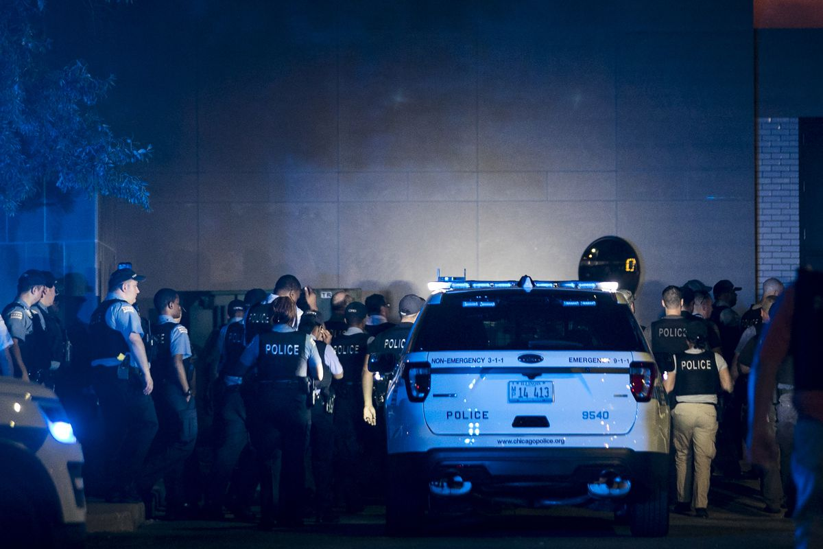 Dozens of Chicago Police officers walk into the Cook County medical examiner's office after a CPD supervisor was found unconscious in his squad car on I-94 near the Stony Island feeder ramp and later pronounced dead at Trinity Hospital, early Sunday, Aug.