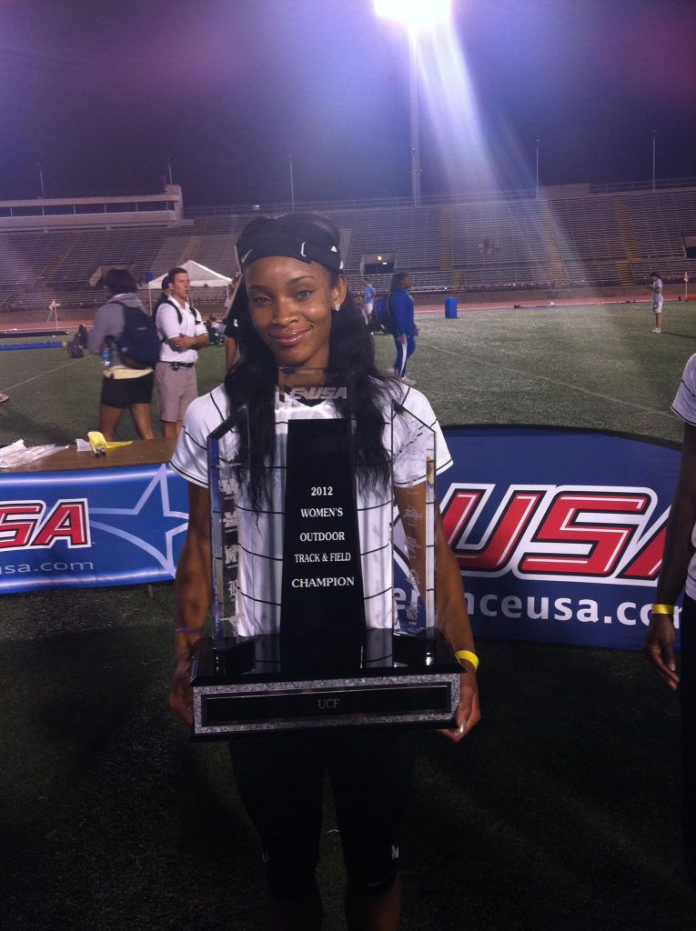 Former UCF hurdler Jackie Coward holds the Conference USA Women's Track and Field Team Championship Trophy following the Knights' victory over the field in 2012. (Photo: Jackie Coward)