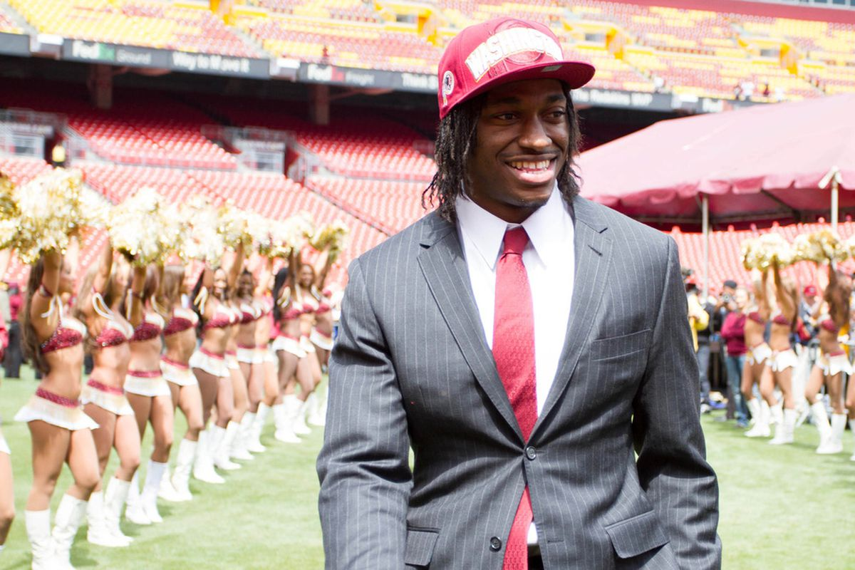 Robert Griffin III got his deal. Maybe Morris Claiborne will get his soon. (Hey, how did those cheerleaders get in there?)