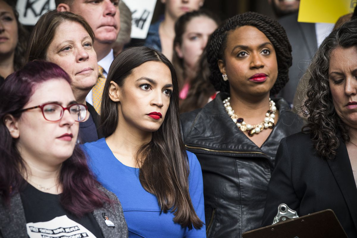 New York Democratic congressional candidate Alexandria Ocasio-Cortez stands with Democratic congressional candidate Ayanna Pressley (right) at a rally calling on Sen. Jeff Flake (R-AZ) to reject Judge Brett Kavanaugh's nomination to the Supreme Court in B