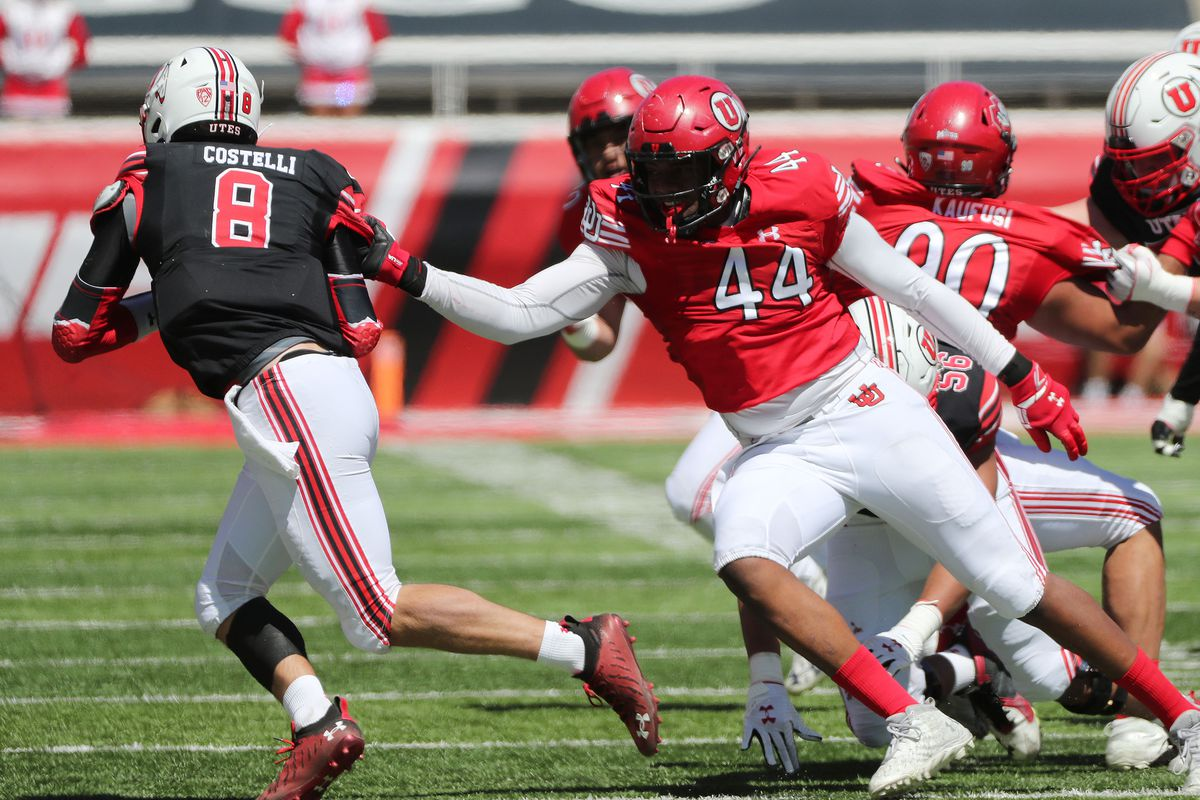 Freshman defensive end Xavier Carlton sacks Peter Costelli in the Red and White game in April in Salt Lake City.