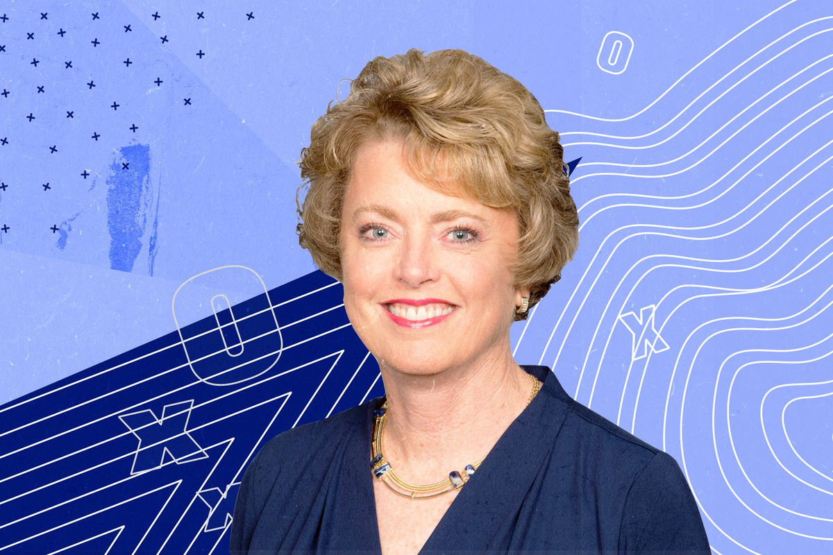 Chargers executive Jeanne Bonk smiles, in front of a blue background with graphics