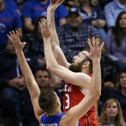 Utah Utes forward David Collette (13) shoots over Brigham Young Cougars forward Luke Worthington (41) at the Marriott Center in Provo on Saturday, Dec. 16, 2017.