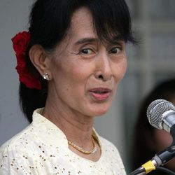 Myanmar's pro-democracy leader Aung San Suu Kyi, left, talks to journalists during a press conference after meeting with the representatives of the Karen National Union (KNU) at her lakeside residence Sunday, April 8, 2012, in Yangon, Myanmar.