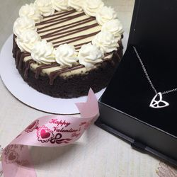 """Cheesecake and necklace delivery deal from Somerville neighbors 7ate9 Bakery and E. Scott Originals (with a charity component). <a href=""""http://7ate9bakery.com/shop-online/"""">Read more.</a>"""