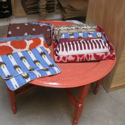 Lingerie bags and clutches in a lacquered Ikat tray