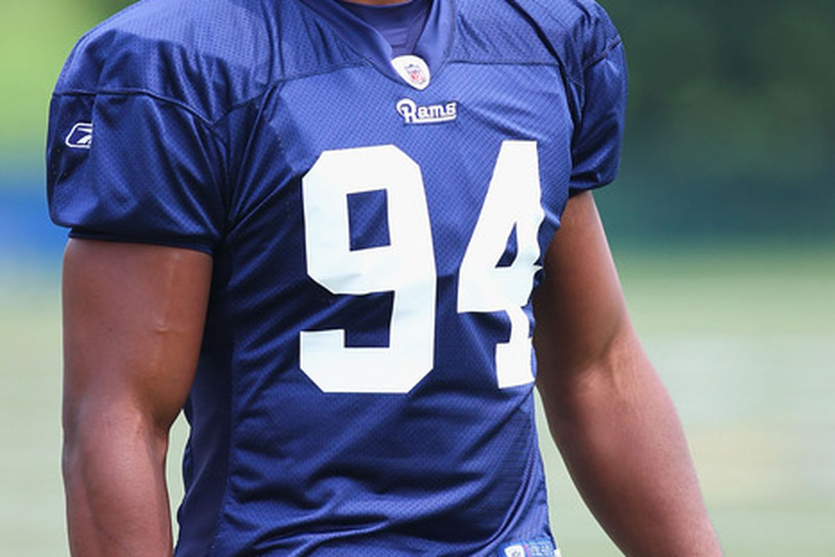 EARTH CITY, MO - JULY 31:  Robert Quinn #94 of the St. Louis Rams takes the field during training camp at the Russell Training Center on July 31, 2011 in Earth City, Missouri.  (Photo by Dilip Vishwanat/Getty Images)