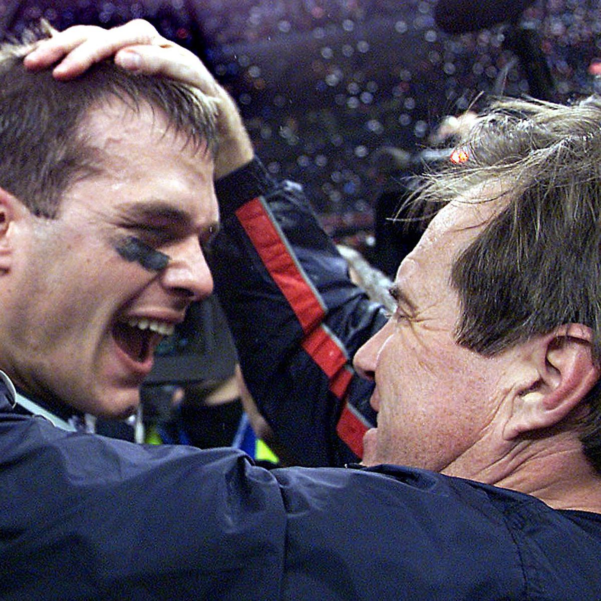 Brady celebrates with Belichick after beating the St. Louis Rams in Super Bowl XXXVI (Jeff Haynes/AFP/Getty Images)