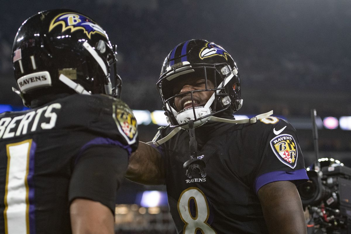 Baltimore Ravens quarterback Lamar Jackson celebrates with Baltimore Ravens wide receiver Seth Roberts after his touchdown reception during the third quarter against the New York Jets at M&T Bank Stadium.